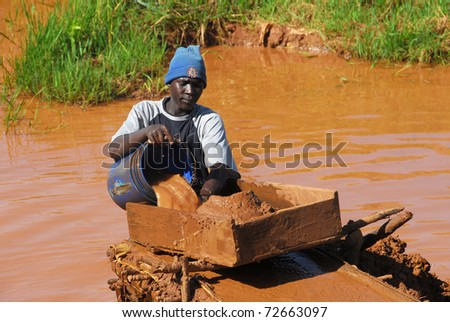 SHINYANGA, TANZANIA - CIRCA MARCH 2010: Gold miner working circa March 2010 in Shinyanga, Tanzania. Tanzania is the third largest gold producer in Africa - stock photo