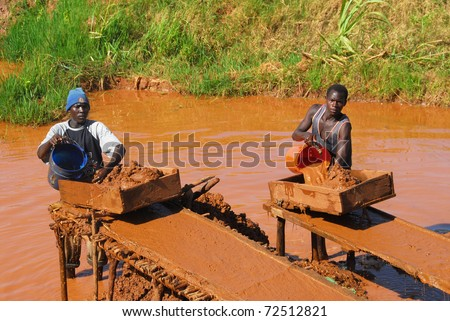 SHINYANGA,TANZANIA CIRCA -MARCH 2010: Gold miners working circa March 18, 2010 in Shinyanga, Tanzania. Tanzania is the third largest gold producer in Africa