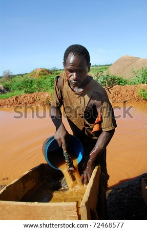 SHINYANGA, TANZANIA-MARCH 18: An unidentified miner looks for gold March 18, 2010in Shinyanga, Tanzania. Tanzania is the third gold producer in Africa after Ghana and South Africa.