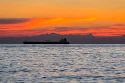 Ship at anchor in the Adriatic Sea, in the background you can see the Dolomites at sunset