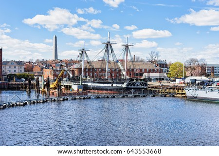 Ship at Charlestown peninsula and Bunher Hill Monument on the background in Boston, MA, the United States.