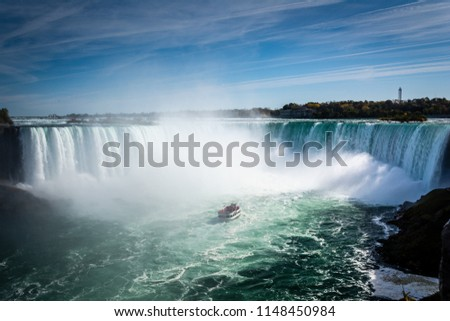 Ship close to Niagara Falls waterfall #1148450984