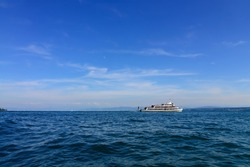 """Ship, ferry vessel cruising on Lake Constance """"Bodensee"""" in Tri-border region of Germany, Switzerland and Austria. Passengers can travel according to summer schedule and reach many destinations."""