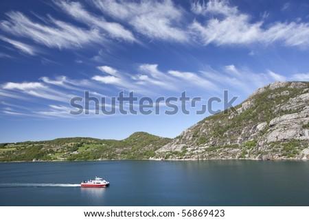 Ship go through the fjord.