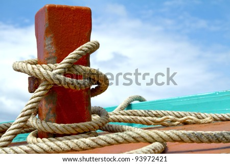 Ship hemp cable bound over a mooring bollard