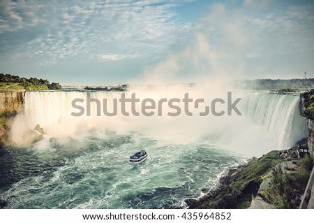 ship in front of horseshoe fall ...