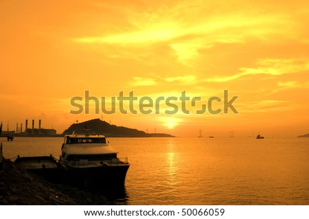 ship in harbour with pink sunset