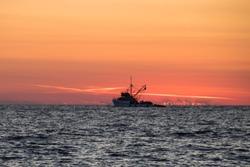 Ship in sunset on the adriatic sea near Dugi Otok, Croatia
