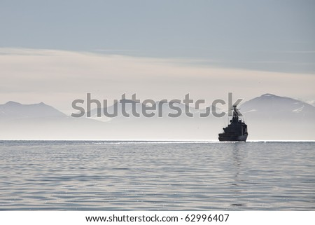 Ship in the fog on a calm sea in Svalbard islands, Norway