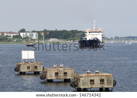 Ship in the harbor in Wismar, Germany. Focus is on the big ship. In front are ship polder