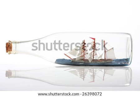 Ship inside a bottle, isolated on white. Concept of how the seemingly impossible can be possible.