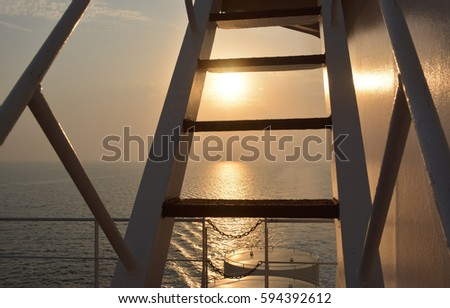 Ship ladder and ocean sunset #594392612