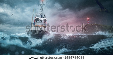 Photo of  Ship lighthouse storm waves sea
