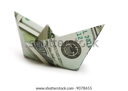 Ship made of money, isolated on white background