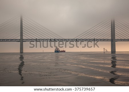 Ship passing under Oresund Bridge in early morning. #375739657