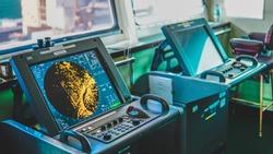 Ship Radar inside bridge room. Shim control room bridge monitor. Navy map yellow monitor