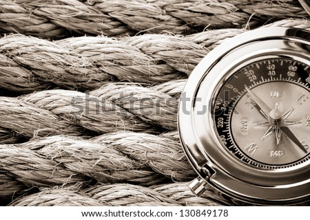 ship ropes and compass