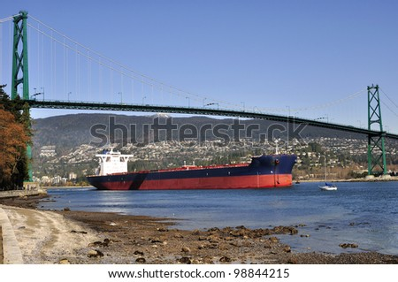 Ship running into the port - stock photo