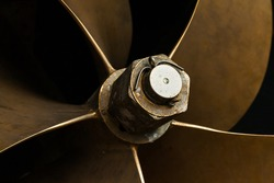 Ship's bronze propeller, close-up. Ship propeller blades.