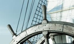 Ship Sail Steering Wheel. Beautiful sailboats under sail on a cruise regatta. Travel and tourism at sea