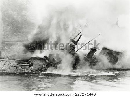 ship sinking into the ocean