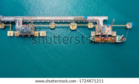 Ship tanker gas LPG, Aerial view Liquefied Petroleum Gas (LPG) tanker, Tanker ship logistic and transportation business oil and gas industry, Loading arm oil and gas offshore platforms.