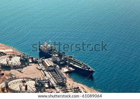 Ship unloading at liquified natural gas terminal