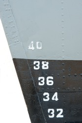 Ship waterline and draft scale numbering.