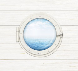 ship window or porthole on wooden wall with sea or ocean visible through it