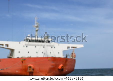 Ship with draft scale numbering side, scrap economic status cloudy, blured background