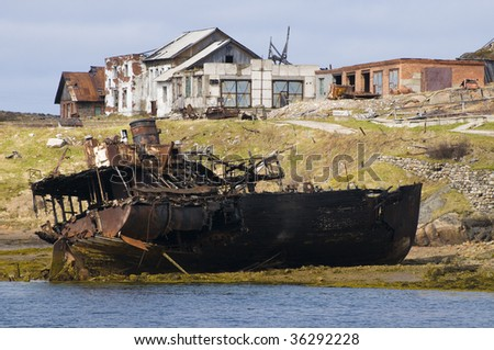 ship wreck in the lost village of russian north - stock photo