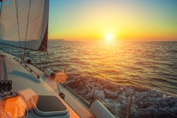 Ship yachts in the open Sea during amazing sunset. Sailing. Luxury boats.