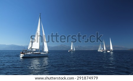 Ship yachts with white sails in the open Sea. Boats in sailing regatta. Sailing yacht race.