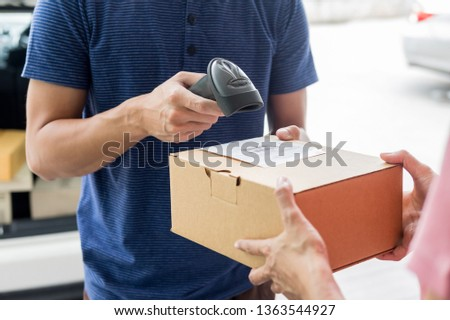 Shipment working delivery service concept, Messenger Leaving Parcel Barcode Scanning checking order to confirm before sending customer  #1363544927