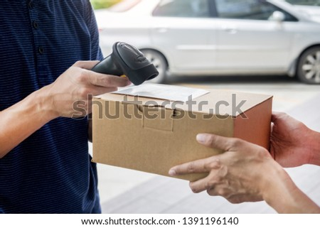 Shipment working delivery service concept, Messenger Leaving Parcel Barcode Scanning checking order to confirm before sending customer  #1391196140