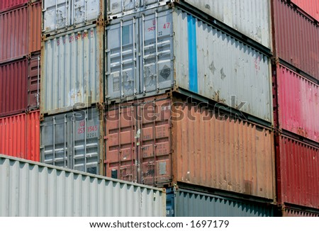 Shipping containers waiting to be loaded on a cargo ship.