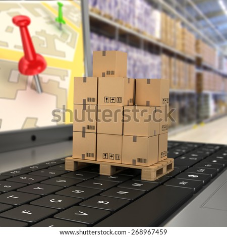 Shipping, delivery and logistics technology business industrial concept: macro view of heap of stacked corrugated cardboard package boxes on computer PC laptop notebook keyboard with selective focus