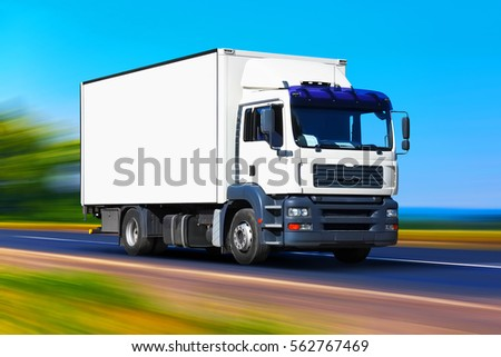 Shipping industry, logistics transportation and cargo freight transport industrial business commercial concept: white delivery truck or container auto car on road, way or highway with motion blur