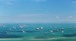 shipping, transport and seafaring concept - boats sailing in ocean