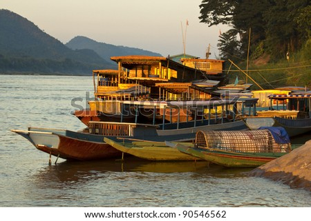 Ships and boats anchored on the river bank of the mekong river