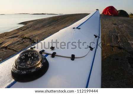 Ships bow with compass on shore - stock photo