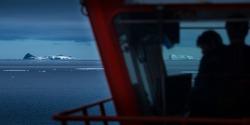 Ships bridge silhouetted with Antarctic Icebergs on the Horizon