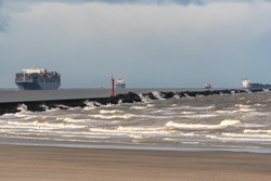Ships heading out to sea with stormy conditions, hoek van holland the netherlands