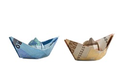 ships  made of euro banknotes isolated on white background