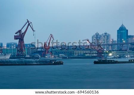 Ships on Huangpu River and cranes at the harbour,shanghai,china. #694560136