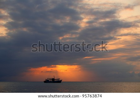 Ships on the sea at sunrise