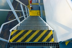 Ships stairs / stairway.  First step off stairway painted in yellow black. Ships anti-slip stairs.