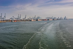 ships unloading containers and cranes in port klang malaysia