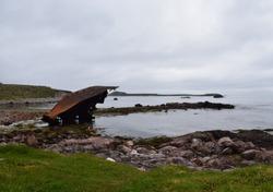 shipwreck along the shoreline of the fishing village Ile aux Marin Saint Pierre, Saint Pierre and Miquelon