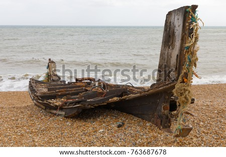 Shipwreck of a fishingboats on the pepple shore in Hastings, UK